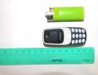 UŽKARDYTAS NAUDOJIMASIS ITIN MAŽU IR SUNKIAI APTINKAMU MOBILIOJO RYŠIO TELEFONU